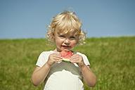 Germany, Bavaria, Girl eating watermelon, portrait - RNF000731