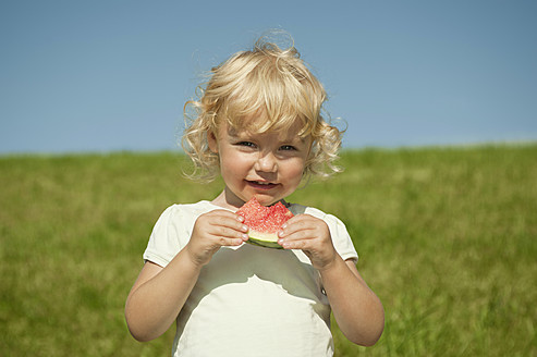 Germany, Bavaria, Girl eating watermelon, portrait - RNF000731