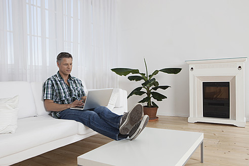Germany, Munich, Mature man using laptop - SKF000640
