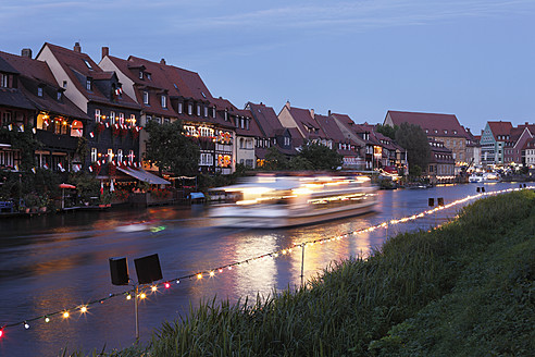 Germany, Bavaria, Franconia, Upper Franconia, Bamberg, View of city  with boat in Regnitz river - SIEF002007