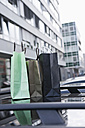 Germany, Cologne, Shopping bags on car roof - FMKF000351