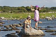 Sweden, Molle, Children balancing on rock in water - SHF000555