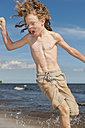 Sweden, Boy running on beach near Borrby - SHF000568