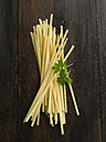 Tagliatelle on wood table, close up - KSWF000781
