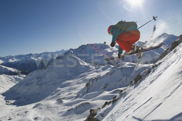 Austria, Tirol, Ischgl, Man ski jumping in snow - FFF001246