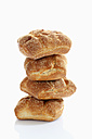 Bread roll of barley and wheat on white background, close up - CSF015517