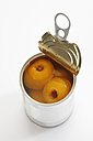 Preserved medlar in tin can on white background - CSF015526