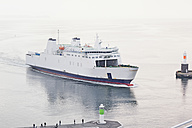 Denmark, Aarhus, View of entering ferryboat at harbour entrance with lighthouse - MSF002575