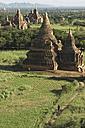 Myanmar, Burma, Bagan, Biker at pagoda temple - FFF001256