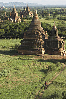 Myanmar, Burma, Bagan, Biker at pagoda temple - FFF001256