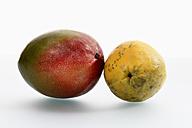 Mango and banana on white background, close up - CSF015609