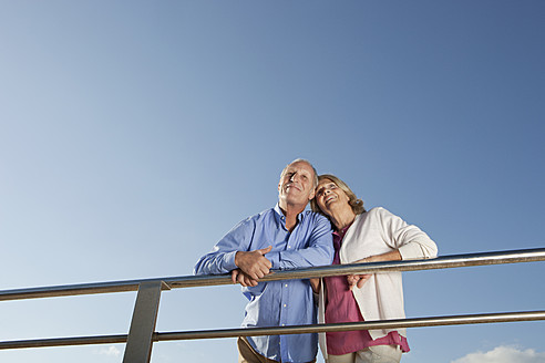 Spain, Mallorca, Senior couple looking away, smiling - SKF000797