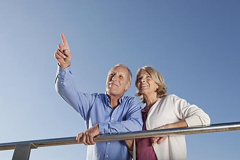 Spain, Mallorca, Senior couple looking away, smiling - SKF000800