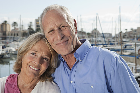 Spain, Mallorca, Palma, Senior couple at harbour, smiling, portrait - SKF000821