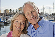Spain, Mallorca, Palma, Senior couple at harbour, smiling, portrait - SKF000824