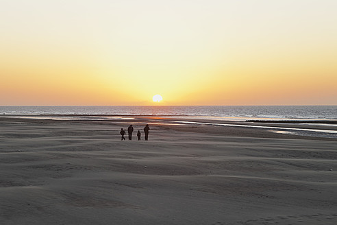 Belgium, Flanders, People on beach at sunset - GW001662