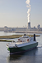 Germany, Rostock, View of ship with harbour and power plant in background - MSF002604