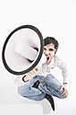 Young man with crazy glasses and megaphone, portrait - MAEF004210