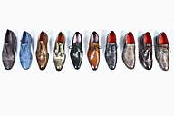 Row of shoes on white background - MAE004145