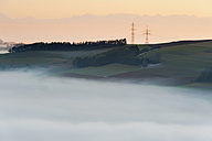 Germany, View of foggy landscape with pylon and Swiss Alps in background - SHF000638
