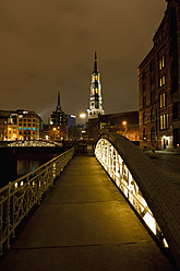 Germany, Hamburg, View of St. Catherine Church and Speicherstadt at night - FOF003802
