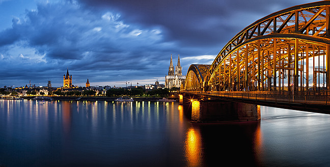 Germany, Cologne, View of Cologne Cathedral, Hohenzollern Bridge and Great Saint Martin Church with River Rhine - FOF003820