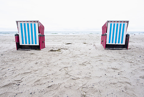 Germany, Rostock, View of hooded beach chair on beach - LFF000316