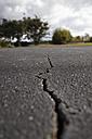 USA, South Carolina, Cracked parking lot - ANBF000129