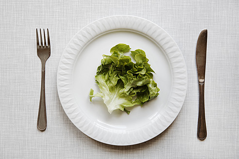 Germany, Salad on plate with fork and knife - ANBF000017