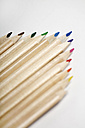 Row of coloured pencils, close up - ANBF000147