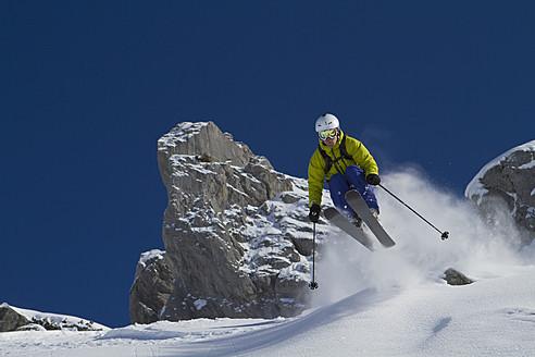 Austria, Arlberg, Warth, Mid adult man skiing - FFF001258