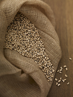 Sack of black eye beans on table, close up - SRSF000221