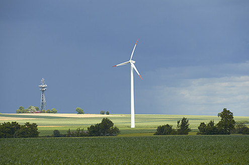 Germany, View of wind turbine and radio tower on landscape - SRSF000229