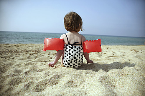 France, Corsica, Girl with armbands on beach - SAF000008