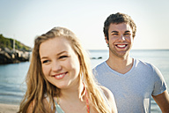 Spain, Mallorca, Couple on beach, smiling - MFPF000003