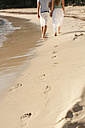 Spain, Mallorca, Couple walking along beach - MFPF000015
