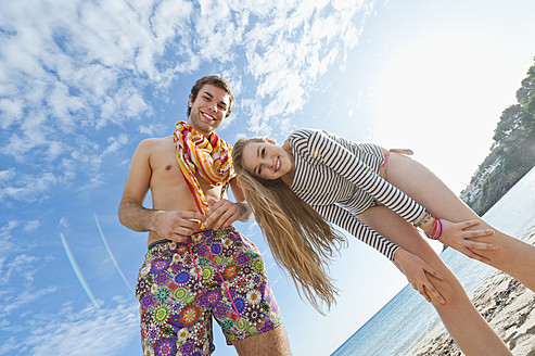 Spain, Mallorca, Couple on beach, smiling, portrait - MFPF000027