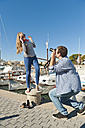 Spain, Mallorca, Couple taking pictures at harbour - MFPF000057