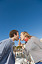 Spain, Mallorca, Couple eating ice cream at harbour, smiling - MFPF000060