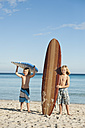 Spain, Mallorca, Children with surfboard on beach - MFPF000075
