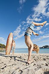 Spain, Mallorca, Children playing on beach - MFPF000078