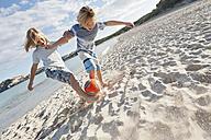 Spain, Mallorca, Children playing soccer on beach - MFPF000081