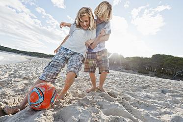 Spain, Mallorca, Children playing soccer on beach - MFPF000084