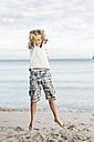 Spain, Mallorca, Boy with water gun on beach, portrait - MFPF000090