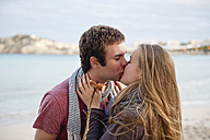 Spain, Mallorca, Couple kissing on beach - MFPF000120