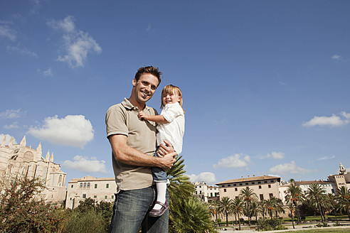 Spain, Mallorca, Palma, Father carrying daughter, smiling - SKF000899