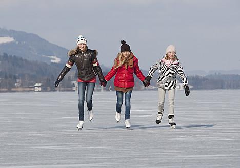 Austria, Teenage girls doing ice skating - WWF002294