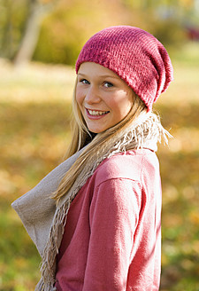 Austria, Teenage girl standing in autumn - WWF002166