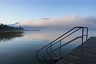 Austria, View of foggy Mondsee Lake during autumn - WWF002209