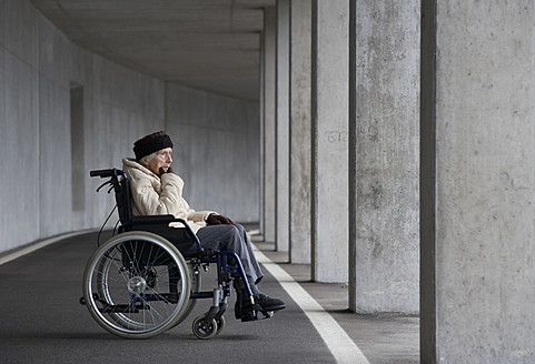 Austria, Senior woman on wheelchair at Subway - WWF002028